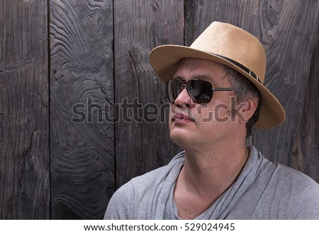 portrait of a man with glasses and hat
