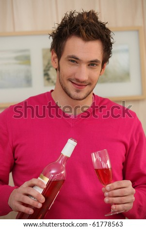 Portrait of a man with goblet and bottle of wine - stock photo