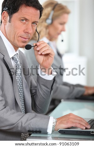 portrait of a man with headset - stock photo
