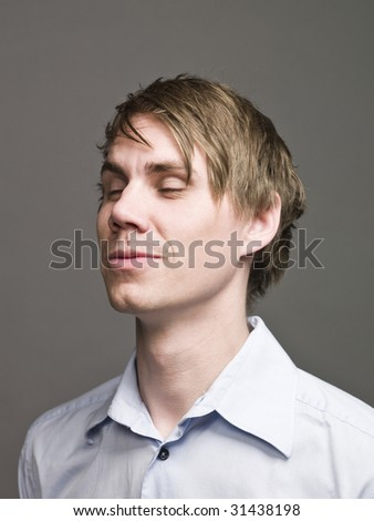 Portrait of a man with his eyes closed - stock photo