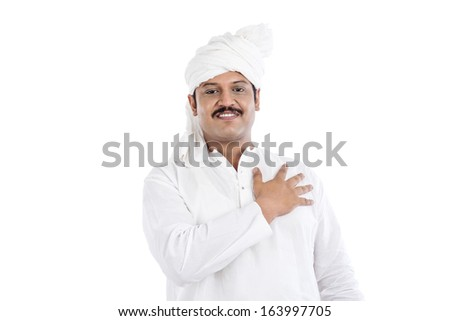 Portrait of a man with his hand on his heart - stock photo