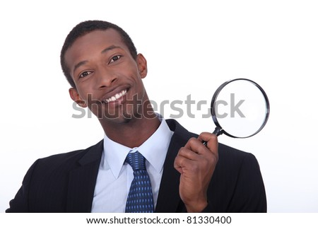 portrait of a man with magnifying glass - stock photo