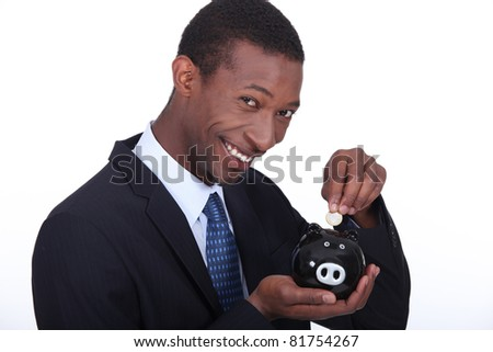 portrait of a man with money box - stock photo