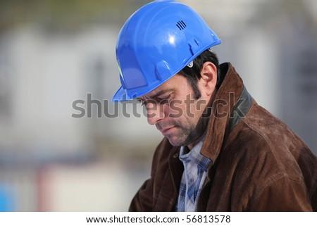 Portrait of a man with safety helmet - stock photo