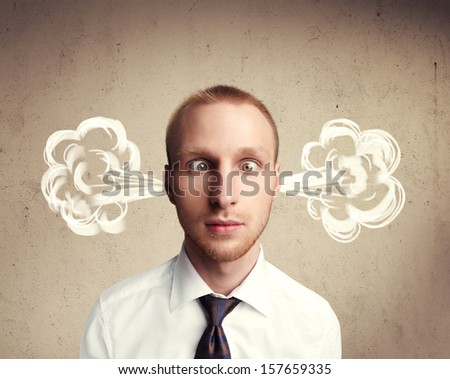 portrait of a man with steam from his ears - stock photo