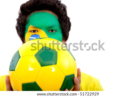 Portrait of a man with the brazilian flag painted on his face holding a soccer ball isolated over white - stock photo