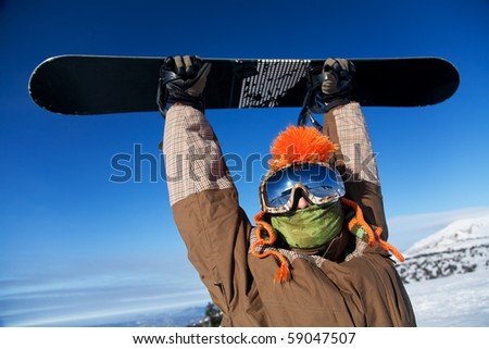 portrait of a man with the snowboard - stock photo