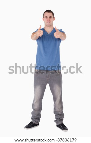 Portrait of a man with the thumbs up against a white background