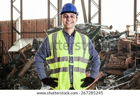 Portrait of a man working in a landfill - stock photo