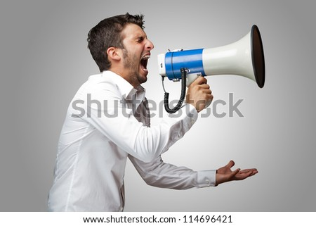Portrait Of A Man Yelling Into A Megaphone, Outdoor - stock photo