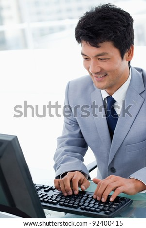 Portrait of a manager using a computer in his office