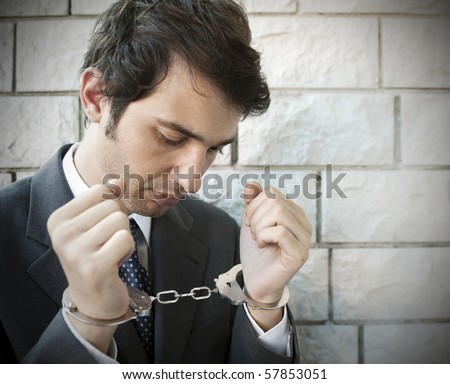portrait of a manager with handcuffs