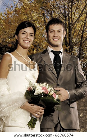 Portrait of a married couple outside the church