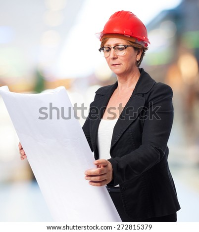 portrait of a mature architect woman holding a plane