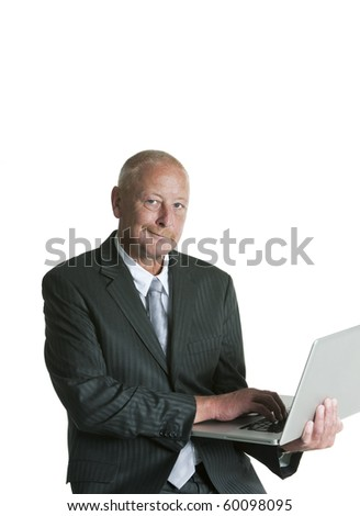 portrait of a mature business man with laptop isolated on white background - stock photo