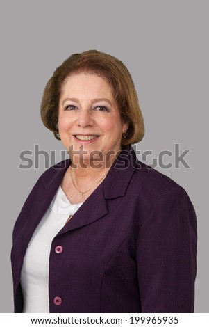 Portrait of a mature business woman isolated on gray background. - stock photo