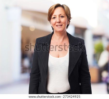 portrait of a mature business woman smiling - stock photo