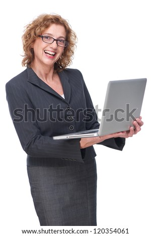 Portrait of a mature business woman smiling and holding laptop in her hand