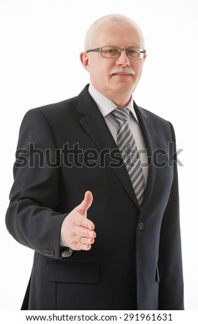 Portrait of a mature businessman offering handshake, white background - stock photo