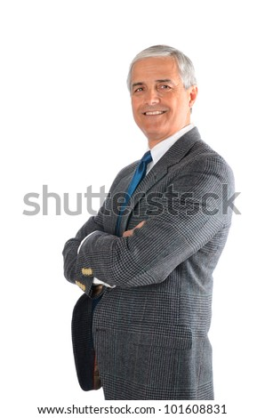 Portrait of a mature businessman with his arms folded isolated on a white background. - stock photo