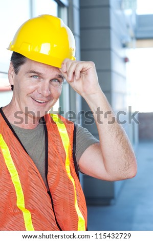 portrait of a mature construction worker outside with hard hat - stock photo