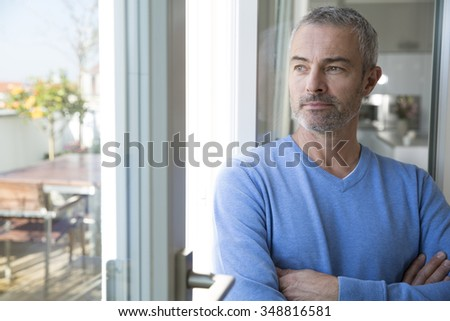 Portrait of a mature man at the window