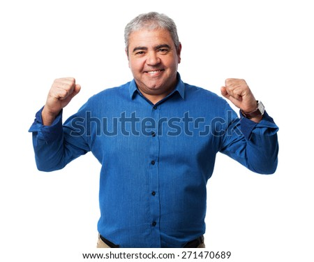 portrait of a mature man doing a victory gesture - stock photo