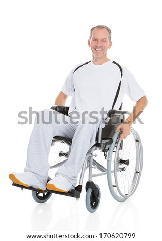 Portrait Of A Mature Man Sitting On Wheelchair - stock photo