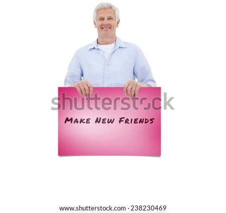 Portrait of a mature man standing behind blank panel against pink card - stock photo