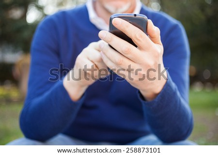 Portrait of a mature man using a mobile phone - stock photo