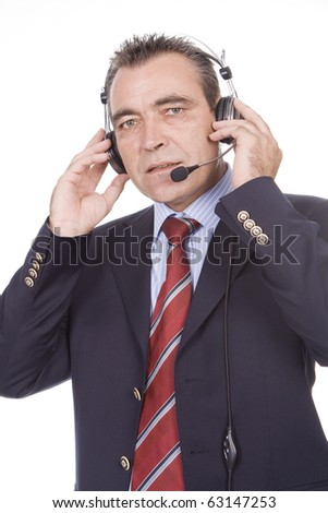 Portrait of a mature man with a headset on - stock photo