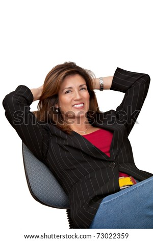 Portrait of a mature pretty businesswoman sitting in a chair with hands behind head.  Very casual on white background. - stock photo