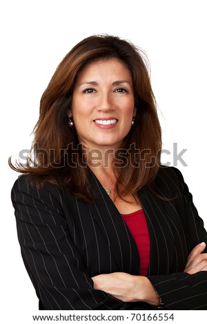 Portrait of a mature pretty businesswoman wearing red blouse and a black jacket. Isolated on white background. Arms are folded. - stock photo