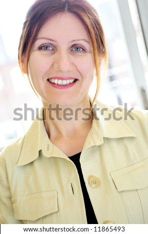 Portrait of a mature smiling business woman - stock photo