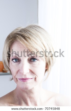 Portrait of a mature woman - stock photo