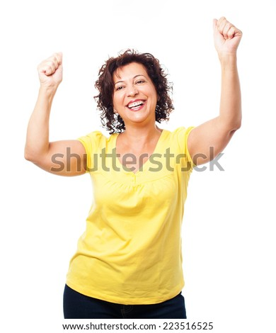 portrait of a mature woman doing a winner gesture - stock photo