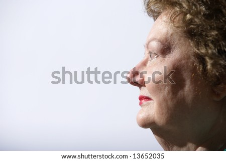 Portrait of a mature woman in the studio - stock photo
