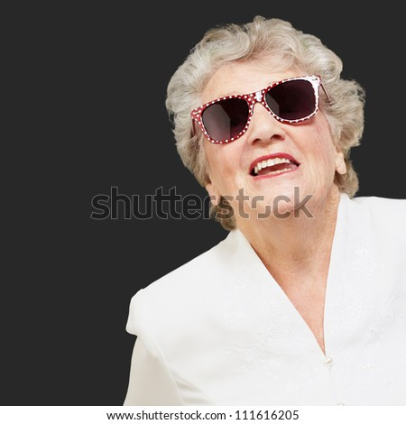Portrait Of A Mature Woman On Black Background - stock photo