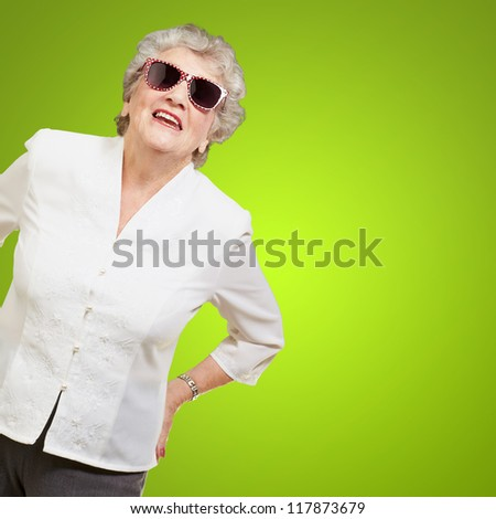 Portrait Of A Mature Woman On Green Background - stock photo