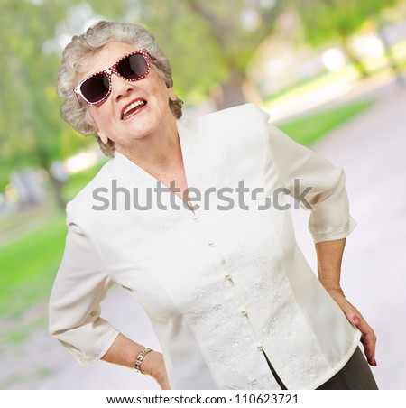 Portrait Of A Mature Woman While Giving Pose, Outdoor - stock photo