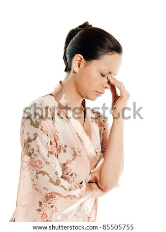 Portrait of a mature woman with headache in studio isolated on white background - stock photo