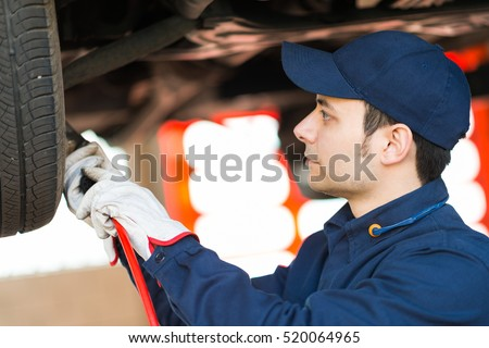 Portrait of a mechanic fixing a car