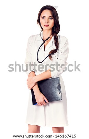 Portrait of a medical employee standing with a clipboard. Isolated over white. - stock photo
