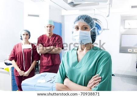 Portrait of a medical team inside operating room - stock photo