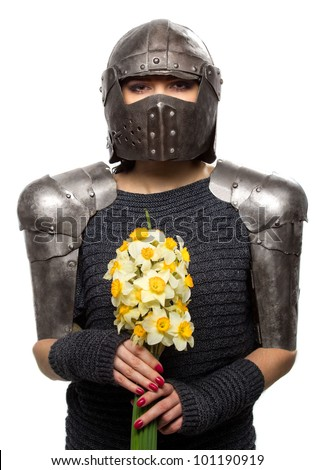 Portrait of a medieval female knight in armour with flowers - stock photo