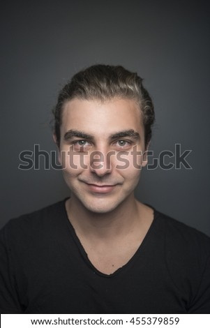 Portrait of a men with in studio gray background - stock photo