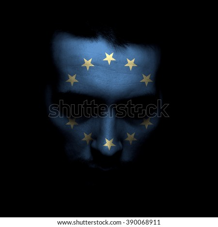 Portrait of a men with the flag of the European union painted on face. - stock photo
