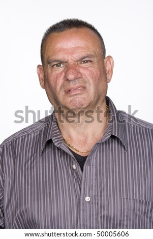 Portrait of a mid adult male. He is looking at the camera with a repulsed expression on his face. Vertical shot. Isolated on white.