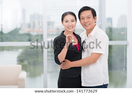 Portrait of a mid-aged couple in their new house - stock photo