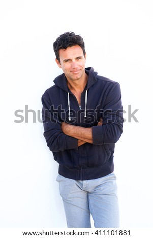 Portrait of a middle aged casual fashion man standing against white background - stock photo